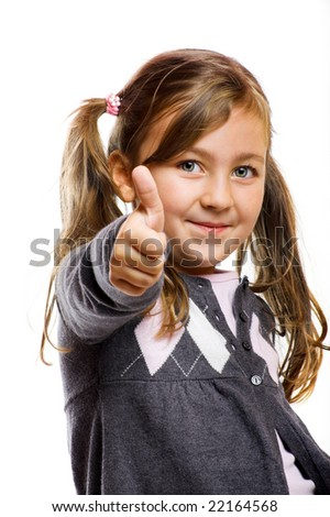 a little girl with thumb up isolated on white background - stock photo