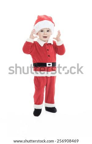 A little happy boy in santa hat portrait - stock photo