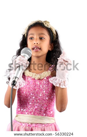 A little Indian girl singing with a mic, on white studio background.