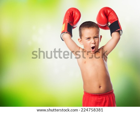 A little kid wearing a boxer gloves - stock photo