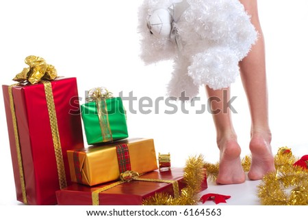 A little legs and xmas presents on white background - stock photo