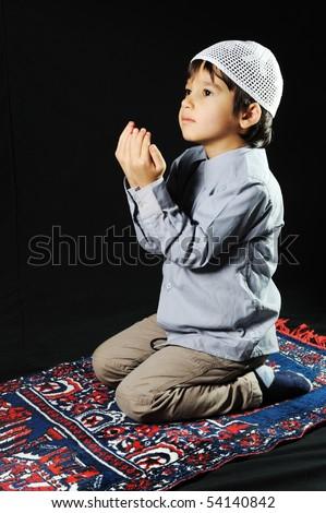 A little muslim praying - stock photo