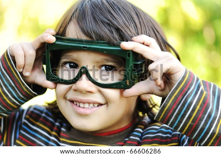 A little pilot, cute little kid outdoor with glasses on eyes - stock photo