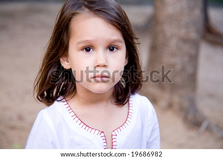 a little serious girl - stock photo
