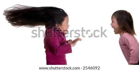 A little sister yells at her older sister, the older sister takes a blast from little sister - stock photo