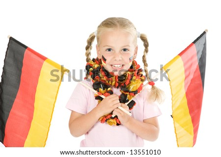 a little soccer fan jubilant with two flags