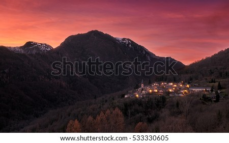 A little village called SUC in the Pyrenees, Ariege, France. Red sky at the sunset in the mountains.