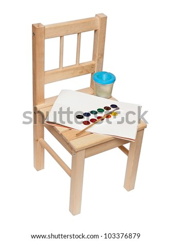 a little wooden chair with paints and brushes to paint isolated on white - stock photo