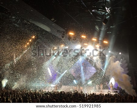a live concert with glitter and spotlights