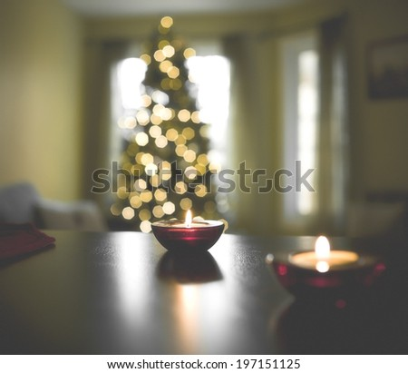 A living room at Christmas with a tree and burning candles. - stock photo