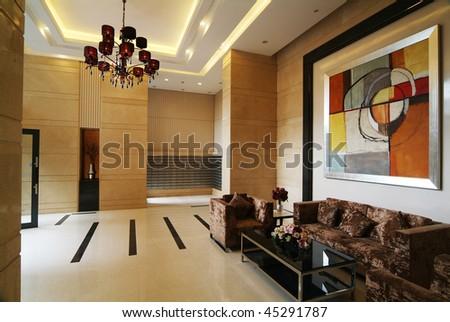 A living room hallway with comfy sofa. - stock photo