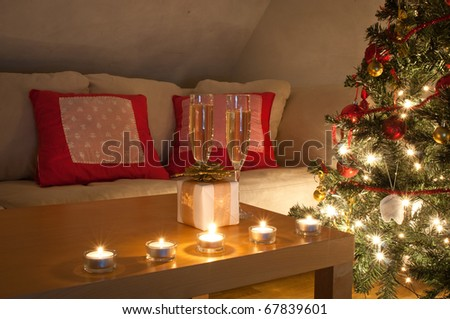 A living room lit by the glow of the Christmas tree. - stock photo