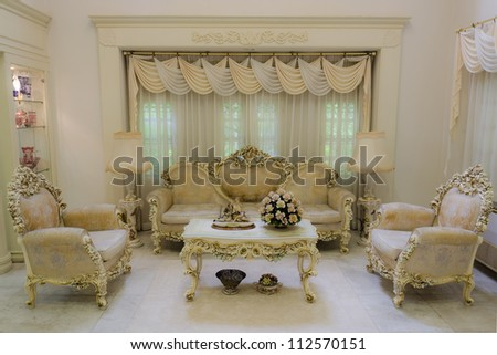 A living room with a luxurious and classical style. - stock photo