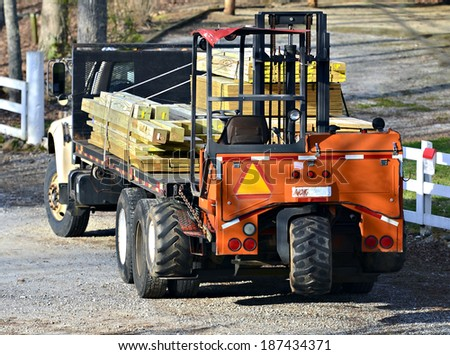 A load of lumber on the way to a job-site. - stock photo