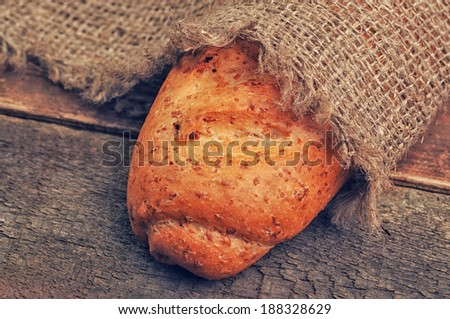 A loaf of bread under a sackcloth - stock photo