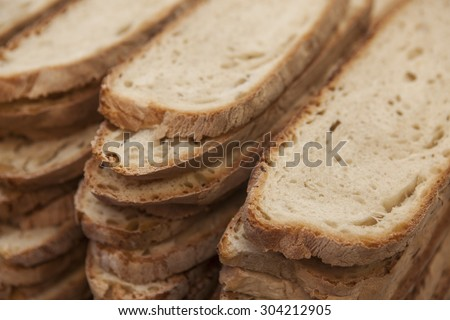 A loaf of homemade sliced bread, meal of durum wheat. - stock photo