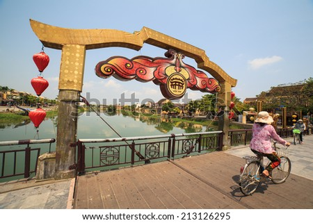 A local woman is on the bridge in early morning, Hoi An, Vietnam