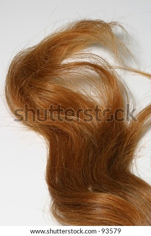 A lock of red hair isolated. - stock photo