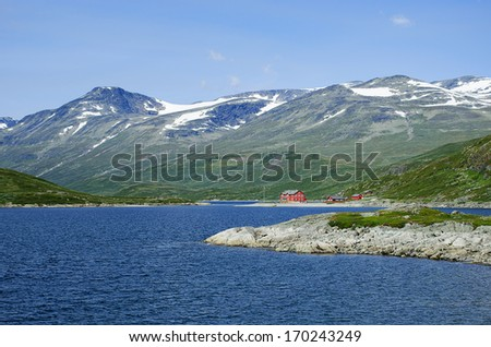 A lodge in Jotunheimen National Park in Norway at lake Bygdin. - stock photo