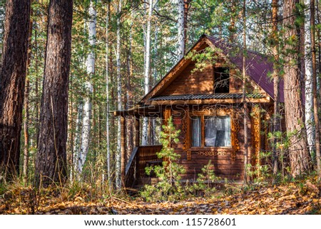 A log cabin in the Russian forest - stock photo