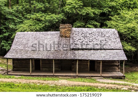 "A log cabin in the woods. The Noah ""Bud"" Ogle Place was a homestead located in the Great Smoky Mountains Park near Gatlinburg, Tennessee. - stock photo"
