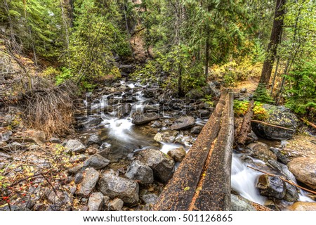 A log lays over Falls Creek near Winthrop, Washington.