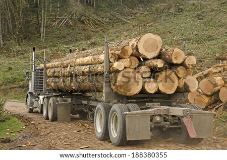 a log truck leaves the site landing with a load of conifer logs destined for the mill in southern Oregon - stock photo