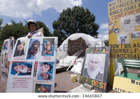A lone anti-war demonstrator outside her tent in Lafayette Park, near the entrance to the White House in Washington, DC, on July 1, 2008. - stock photo