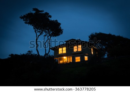 A lone house at night - stock photo