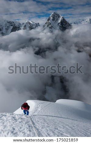 A lone mountaineer trying to reach the summit of Lobuche peak in Nepal.  - stock photo