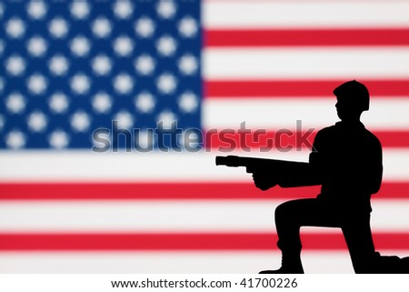 A lone toy soldier on an American flag background.