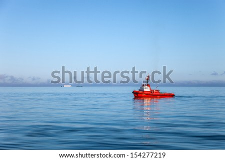 A lone tugboat out at sea.  - stock photo