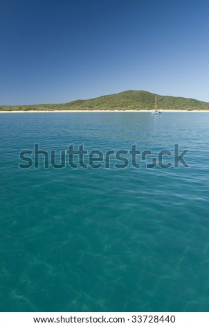 A lone yacht moored off great keppel island, queensland, australia