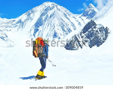 A lonely climber reaching the summit - stock photo