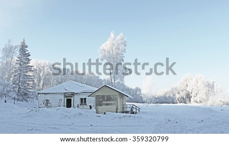 A lonely house in winter forest