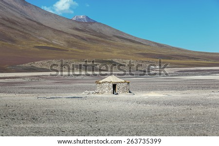 A lonely hut in the lifeless Altiplano high plateau, Boliviav, Latin America - stock photo