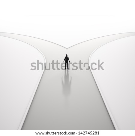 A lonely man on a crossroad - stock photo