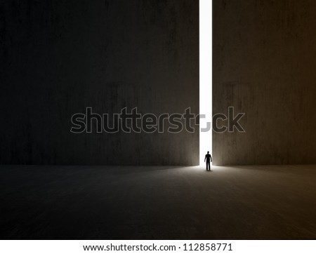 A lonely person walking through a narrow passage - stock photo