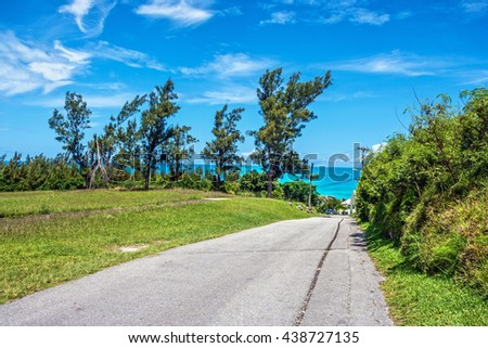 A lonely road leading to Tobacco Bay in scenic Bermuda. - stock photo