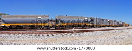 A long cargo train on the tracks - stock photo