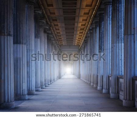 A long corridor between many columns - stock photo