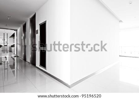A long corridor, modern building interiors - stock photo