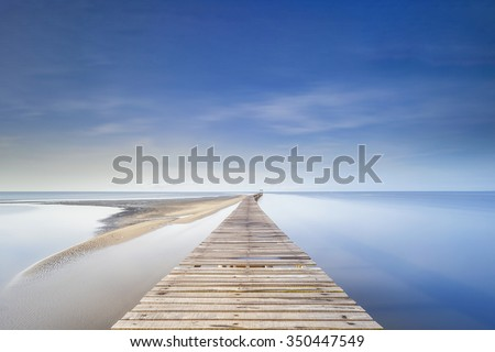 A long exposure at blue sky of a jetty in Australia - stock photo