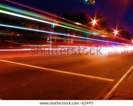 a long exposure of cars on the street, colorful