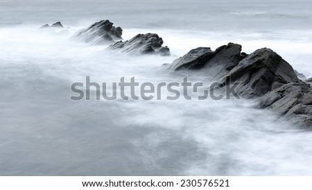 A long exposure photography with sea rocks - stock photo