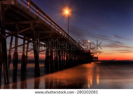 A long exposure shot at Newport beach pier after the sunset - stock photo