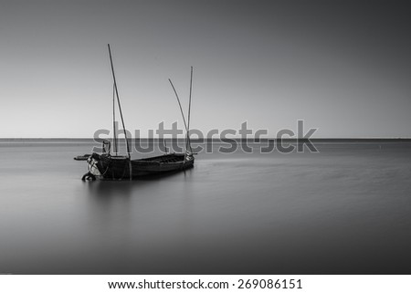 A long exposure shot of abandoned old boat  - stock photo