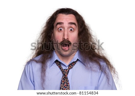 A long haired man with a surprised expression 1 - stock photo