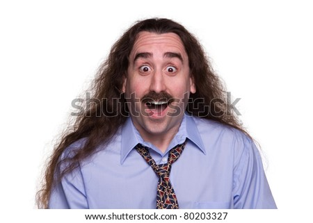 A long haired man with a surprised & happy expression 1 - stock photo