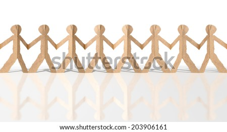 A long row of brown cardboard cutout men on an isolated white studio background